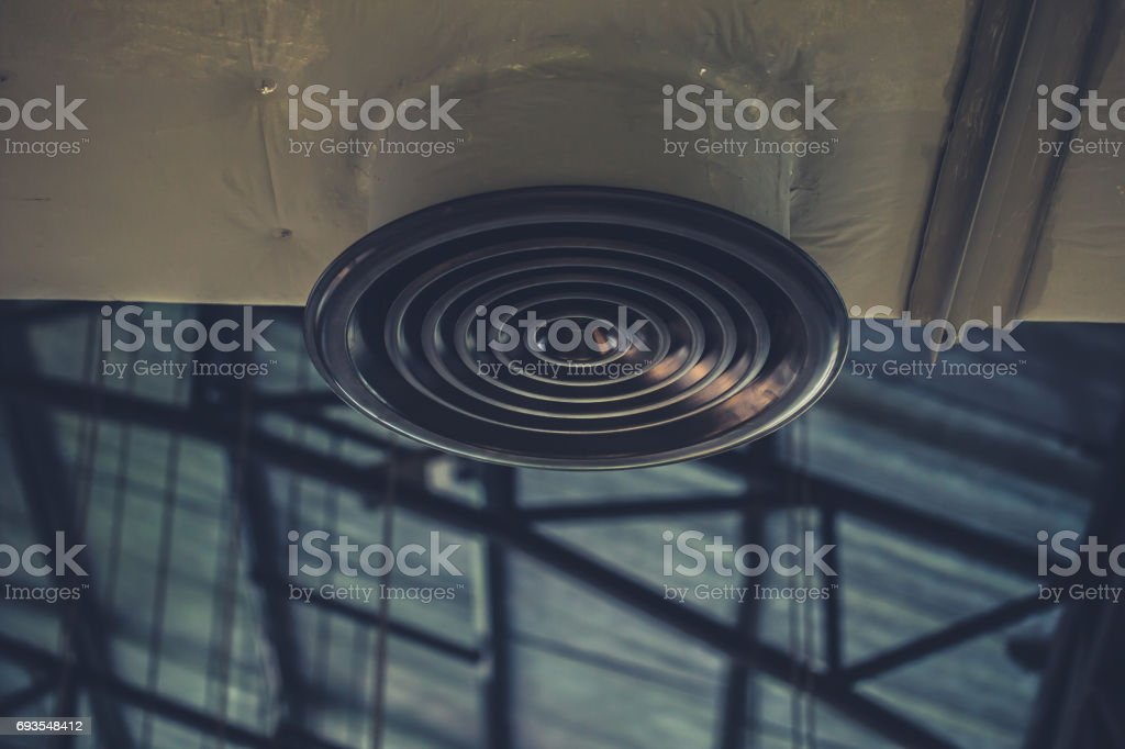Industrial Airflow in factory, Air duct, Danger and the cause of pneumonia in office man. stock photo