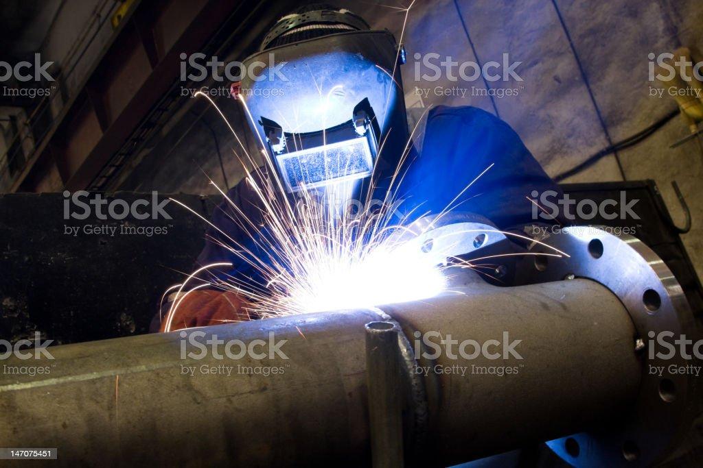 industrial arc welder working in factory stock photo
