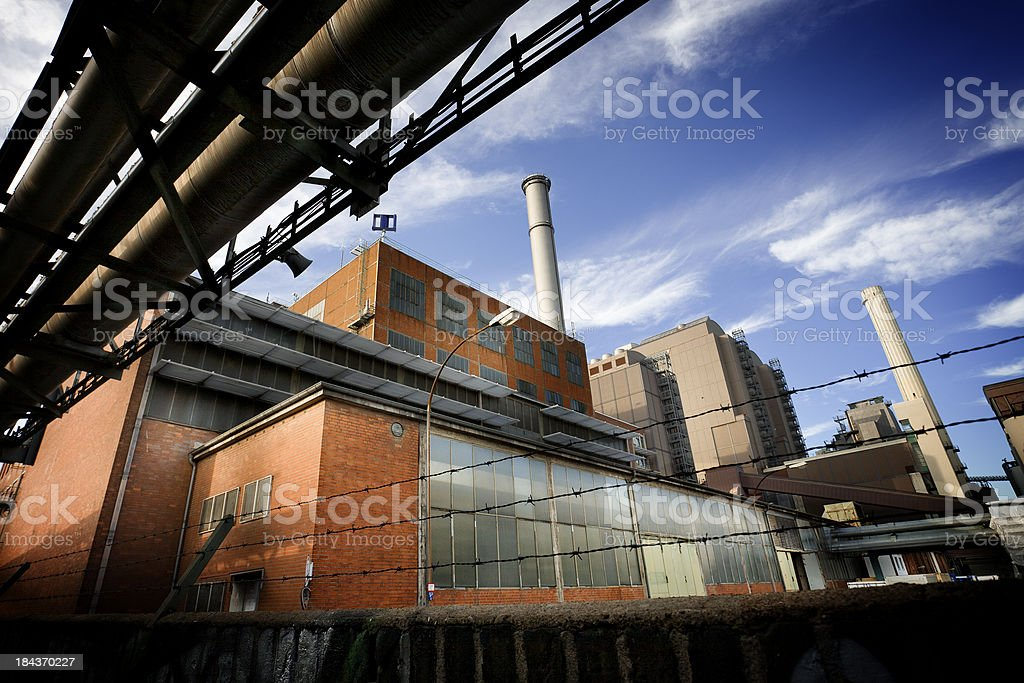 Industrial area against blue sky royalty-free stock photo