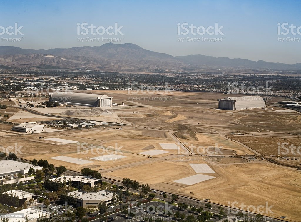 Industrial area of El Toro with mountains in background stock photo