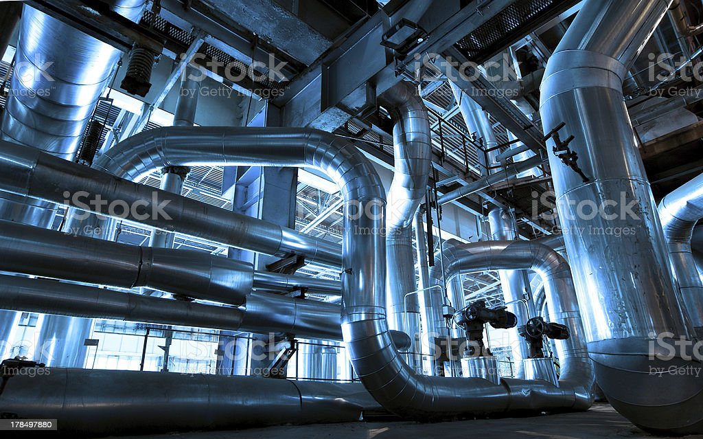 Industrial area with steel pipelines and cables stock photo