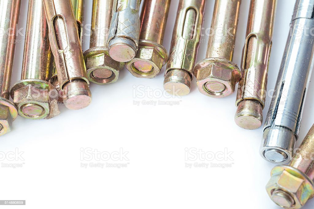 industrial background with copyspace- metalic anchors for concrete wall stock photo