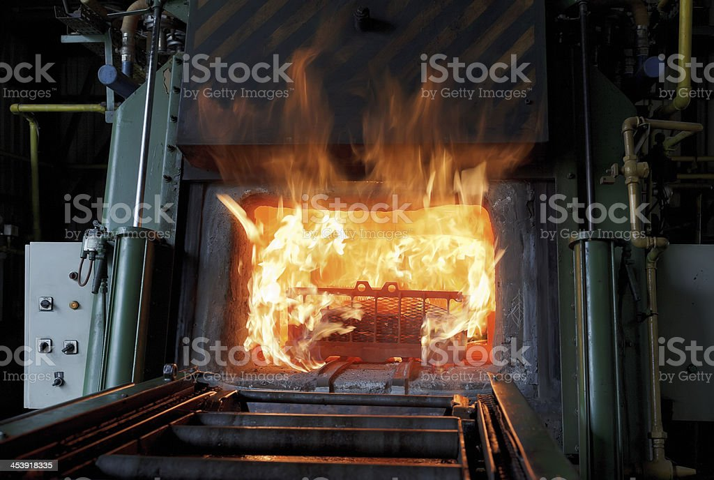 Industrial Blast furnace fire framed with metal steel stock photo