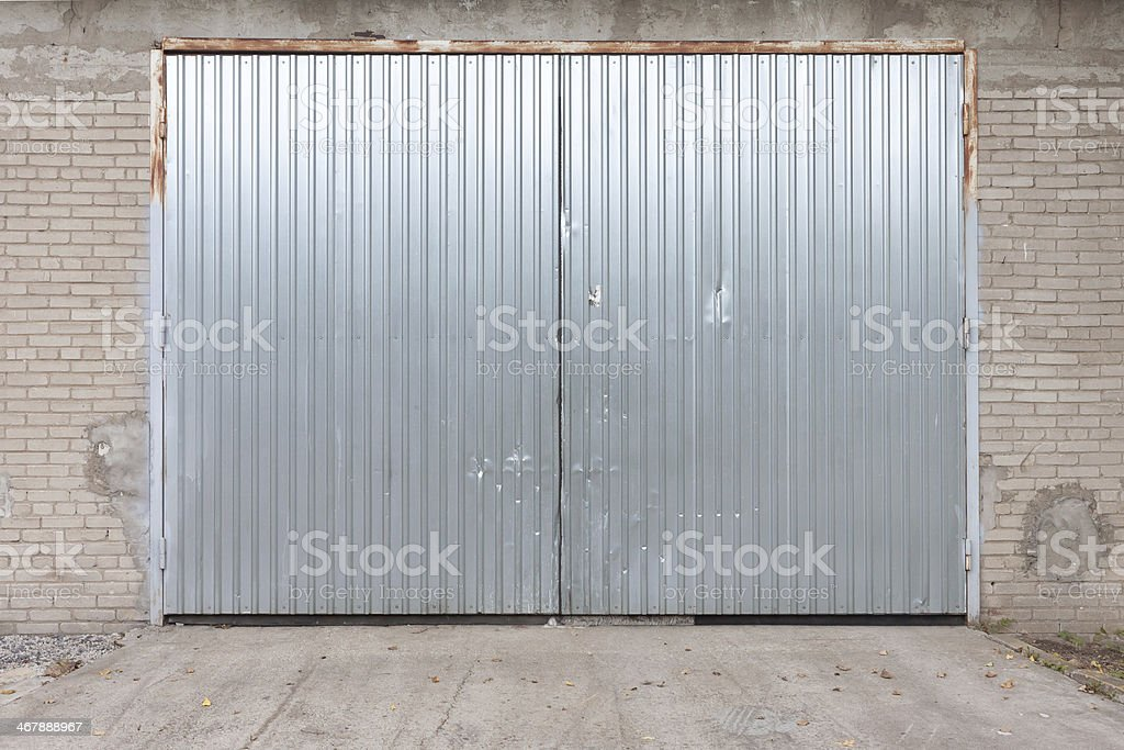 Industrial building made of concrete with door stock photo