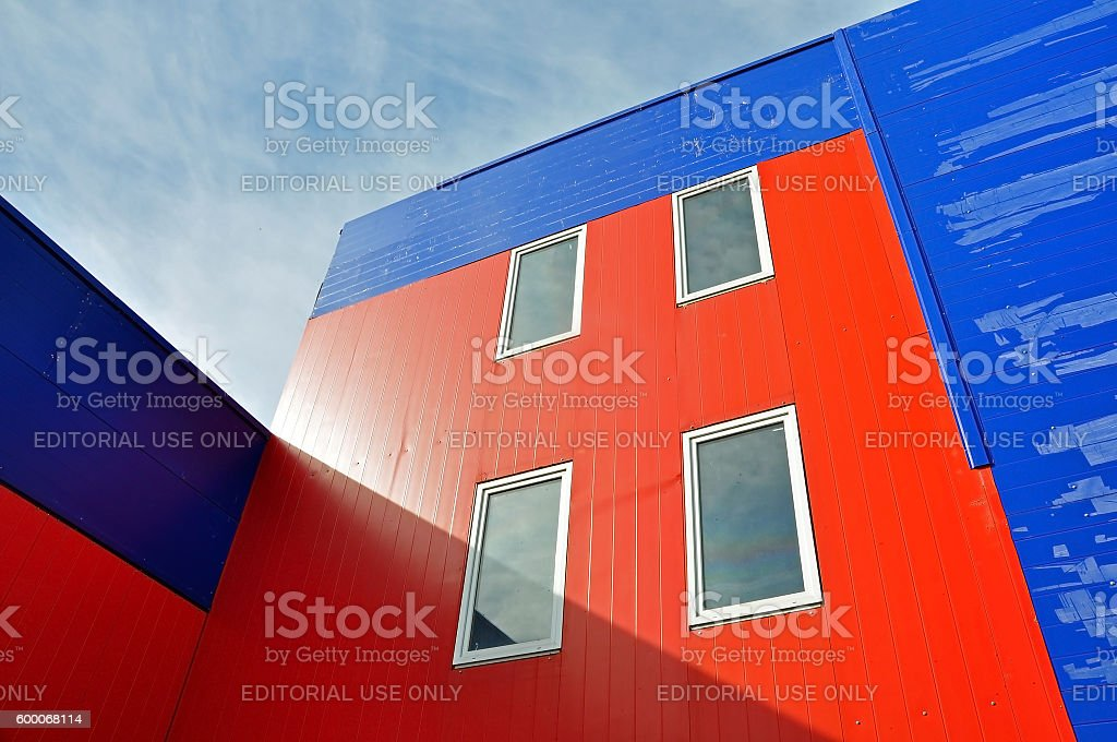 Industrial building of red and blue sandwich panels. stock photo