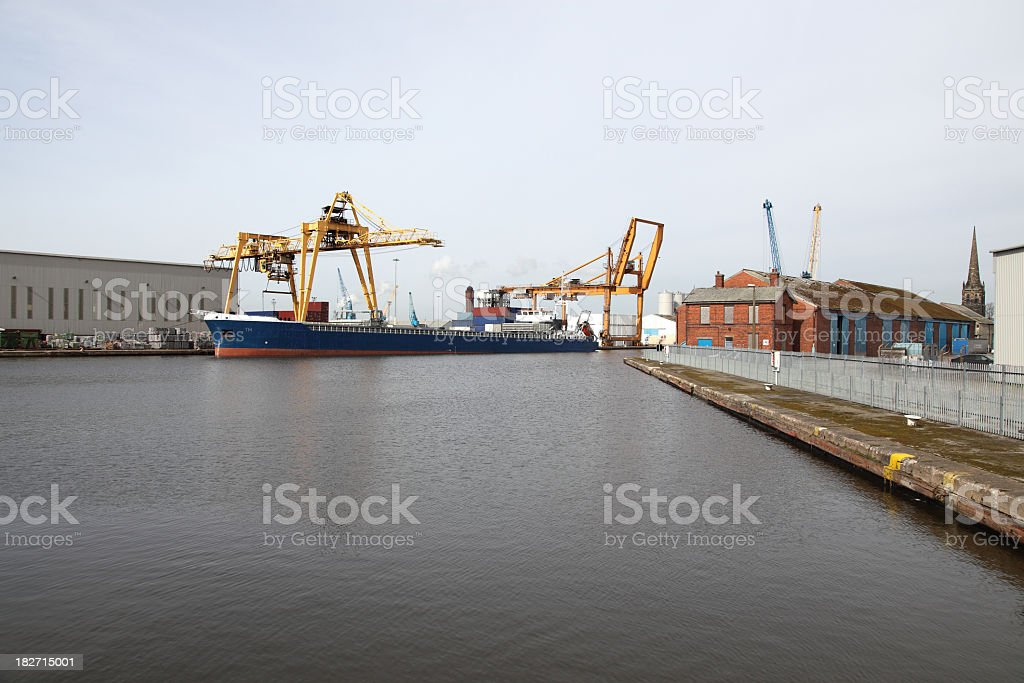 industrial buildings and ship in docks stock photo