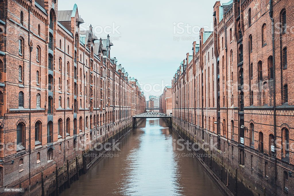 Industrial canal and warehouses in Speicherstadt stock photo