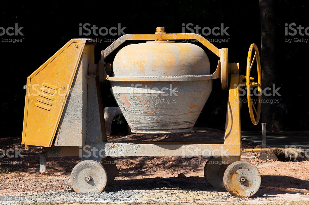 Industrial cement mixer machine at construction site. stock photo