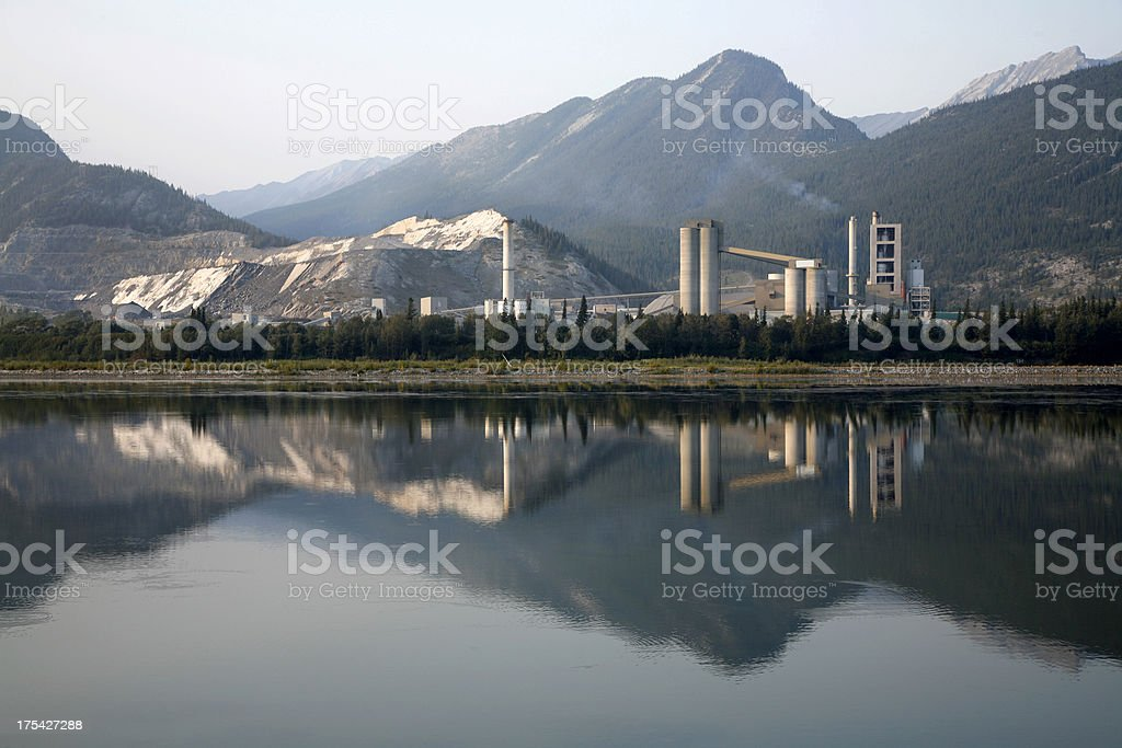 Industrial Cement Plant With Mountain reflections. royalty-free stock photo