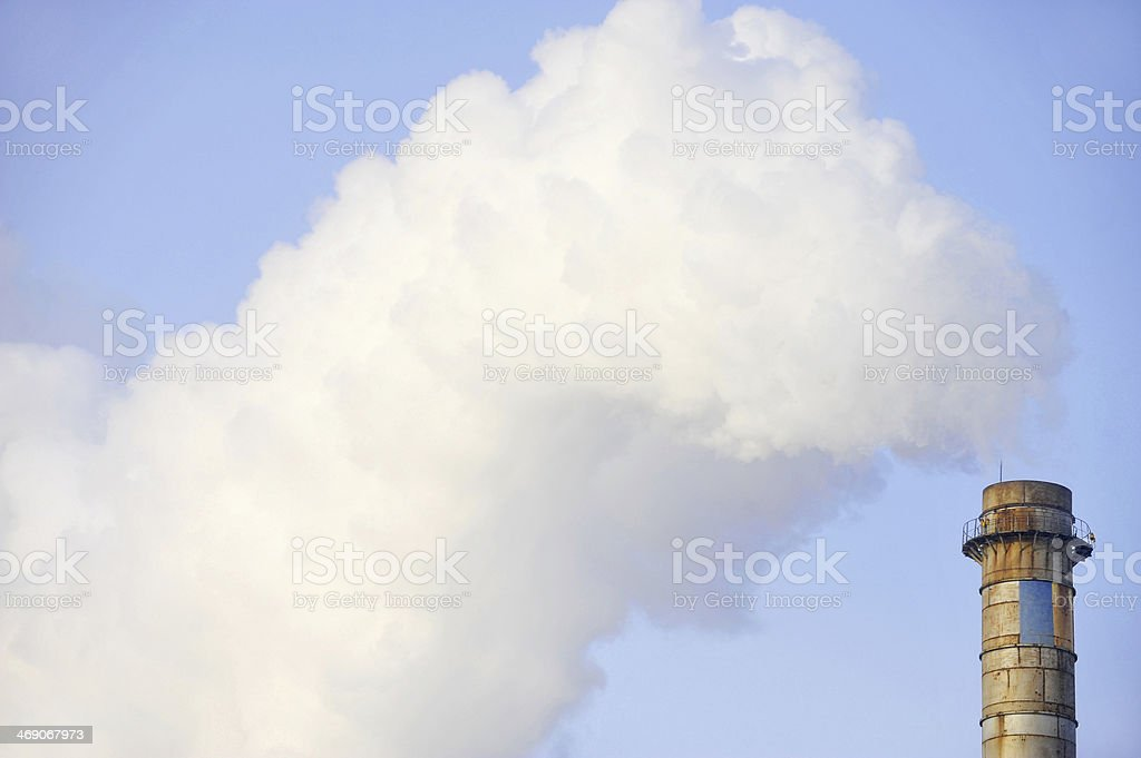 Industrial chimney with huge cloud of smoke royalty-free stock photo