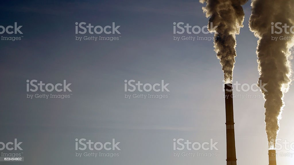 industrial chimneys emits toxic pollutants into the sky polluting the stock photo