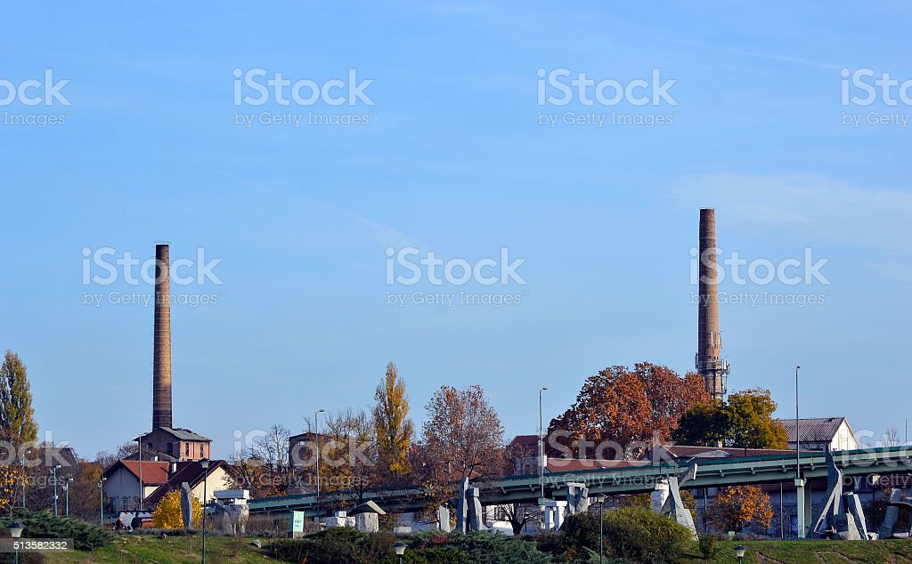Industrial chimneys in the city stock photo
