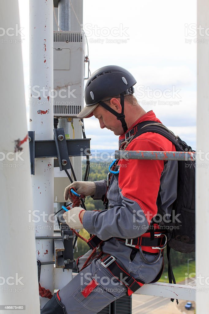 industrial climber on a cellular tower stock photo