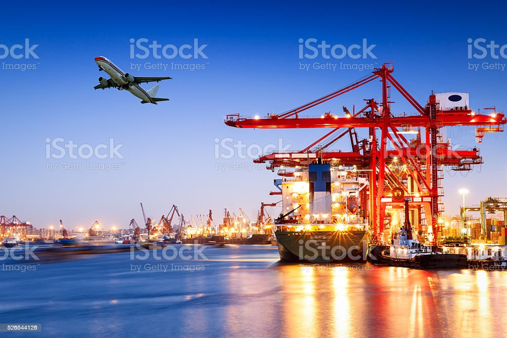 Industrial container freight Trade Port scene at night stock photo