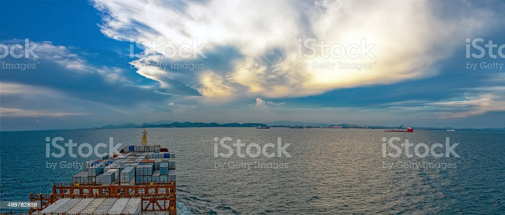 Industrial container ship enters the Laem Chabang bay stock photo