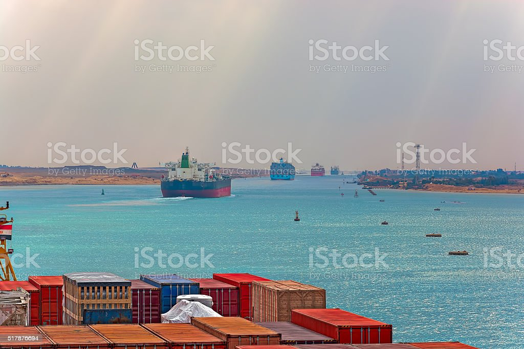 Industrial container ship passing through Suez Canal with ship's stock photo