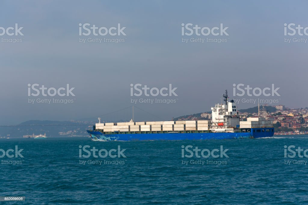 industrial container ship travel at bosphorus strait of istanbul turkey stock photo