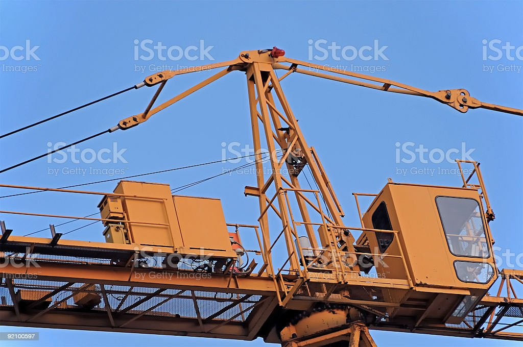 Industrial crane cabine against clear blue sky, close up royalty-free stock photo