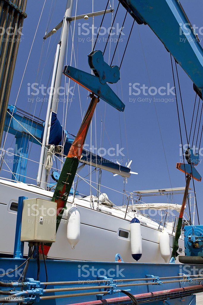 Industrial crane lifting ship stock photo