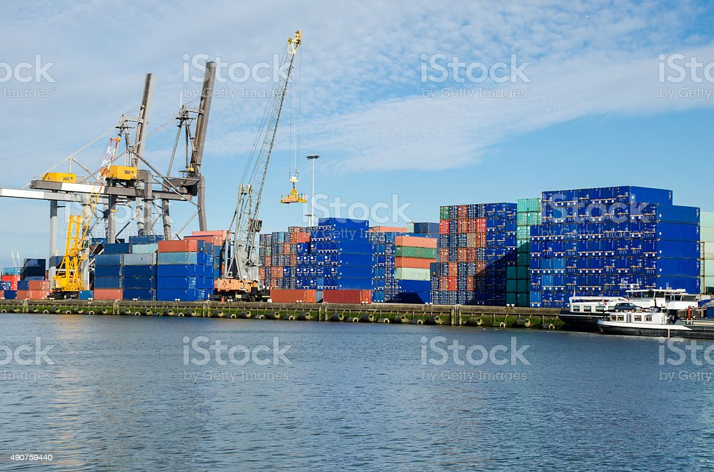 Industrial crane loading Containers in the port of Rotterdam, Netherlands. stock photo