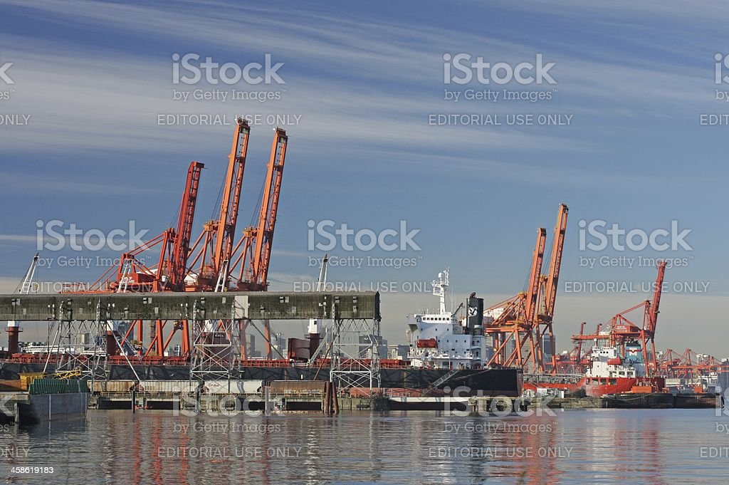 Industrial Cranes at Port Metro Vancouver in Burrard Inlet, Canada royalty-free stock photo