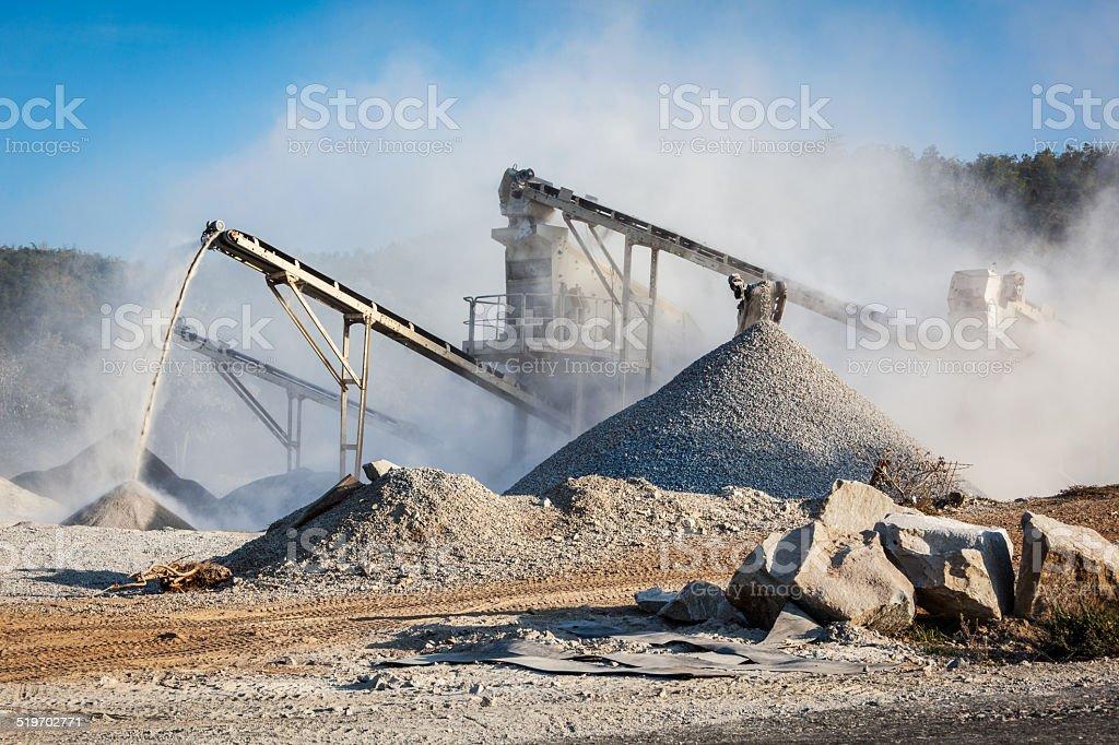 Industrial crusher - rock stone crushing machine stock photo