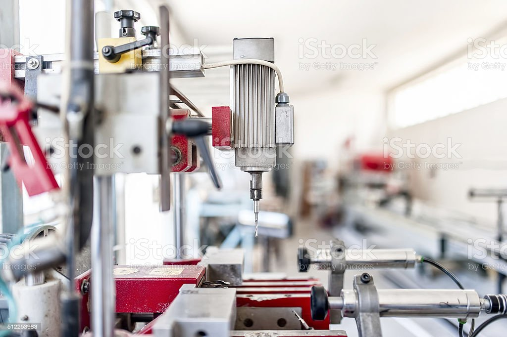 industrial drilling machinery with automatic process. Factory drilling stock photo