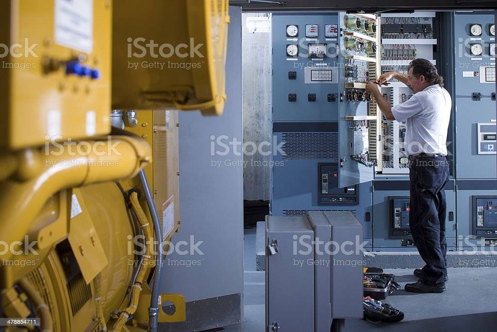 Industrial electrician stock photo