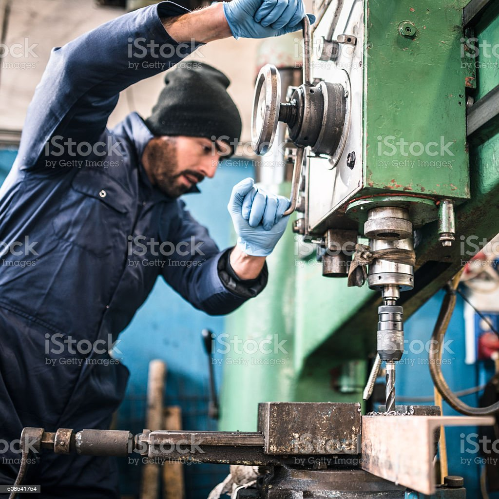 industrial engineer at the lathe machine stock photo
