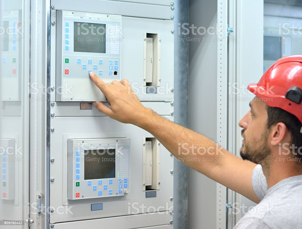 Industrial Engineer Touching Control Panel stock photo