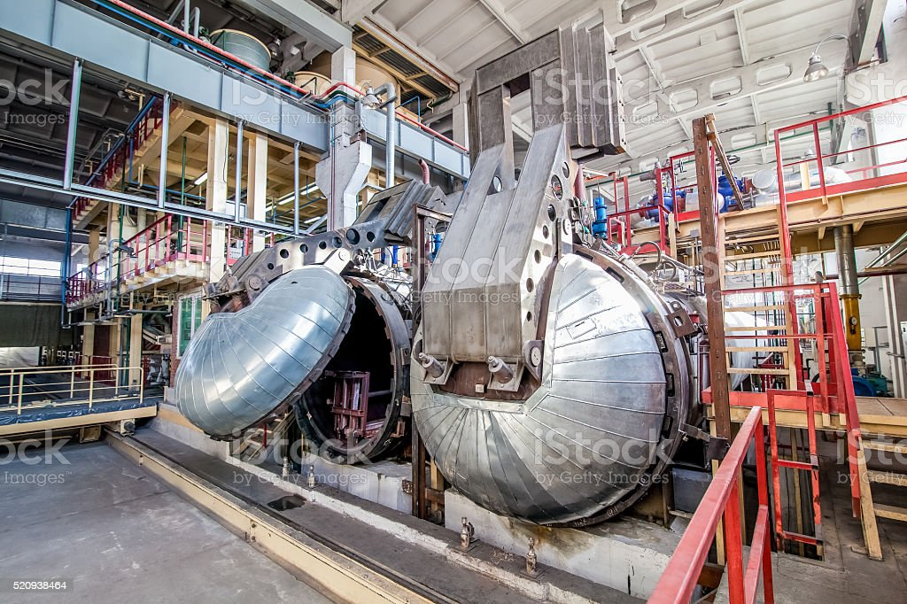 industrial equipment at the factory in large  production hall stock photo