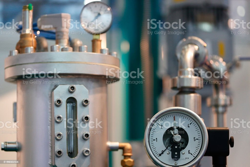 industrial equipment with pressure gauge stock photo