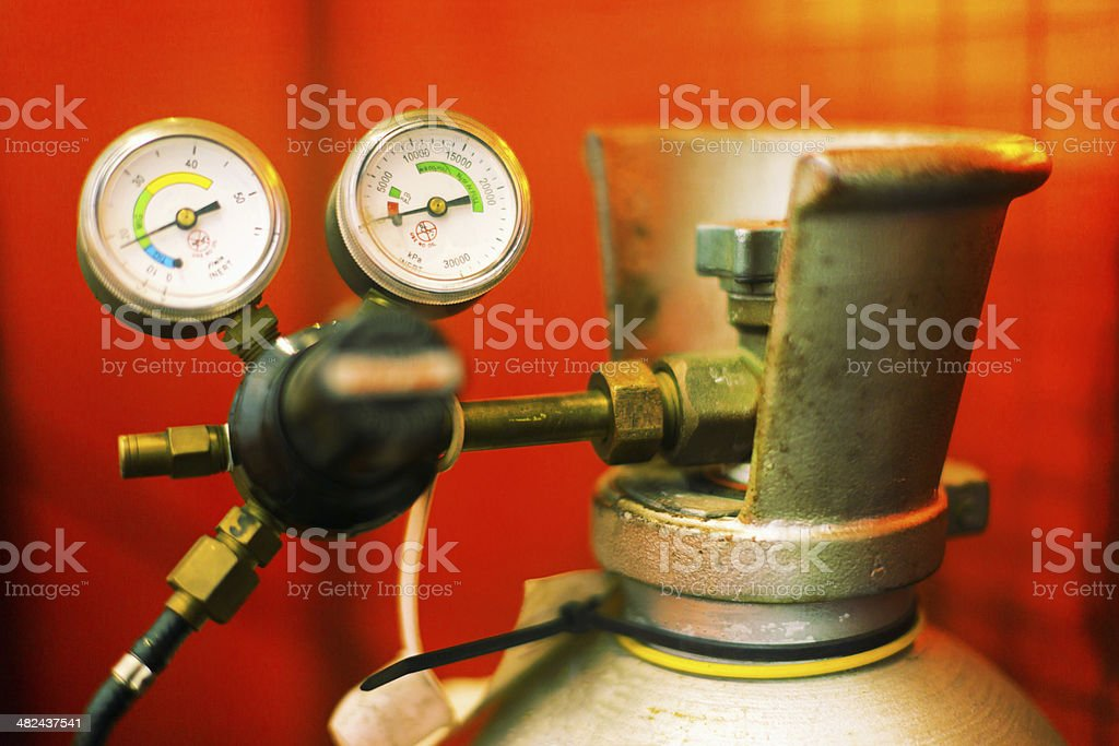 Industrial gas cylinder with pressure gauges royalty-free stock photo