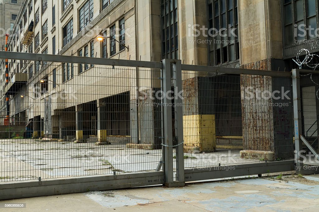 Industrial gate and abandoned building. stock photo