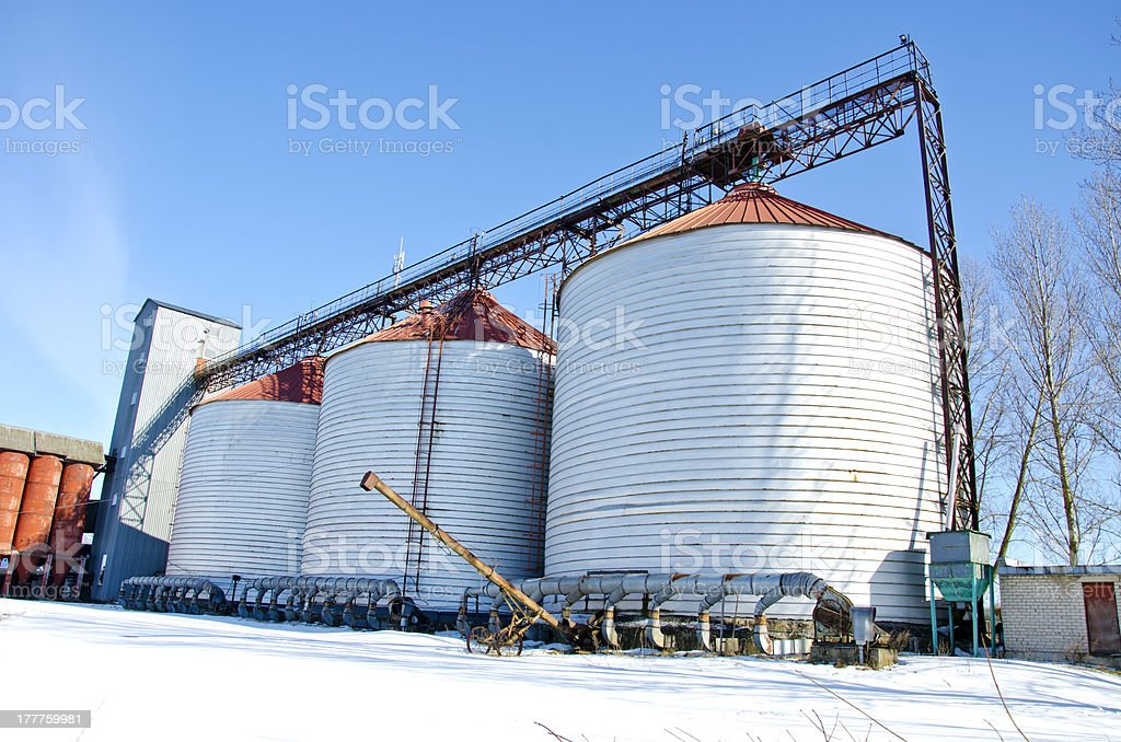 industrial grain silos construction in winter time royalty-free stock photo