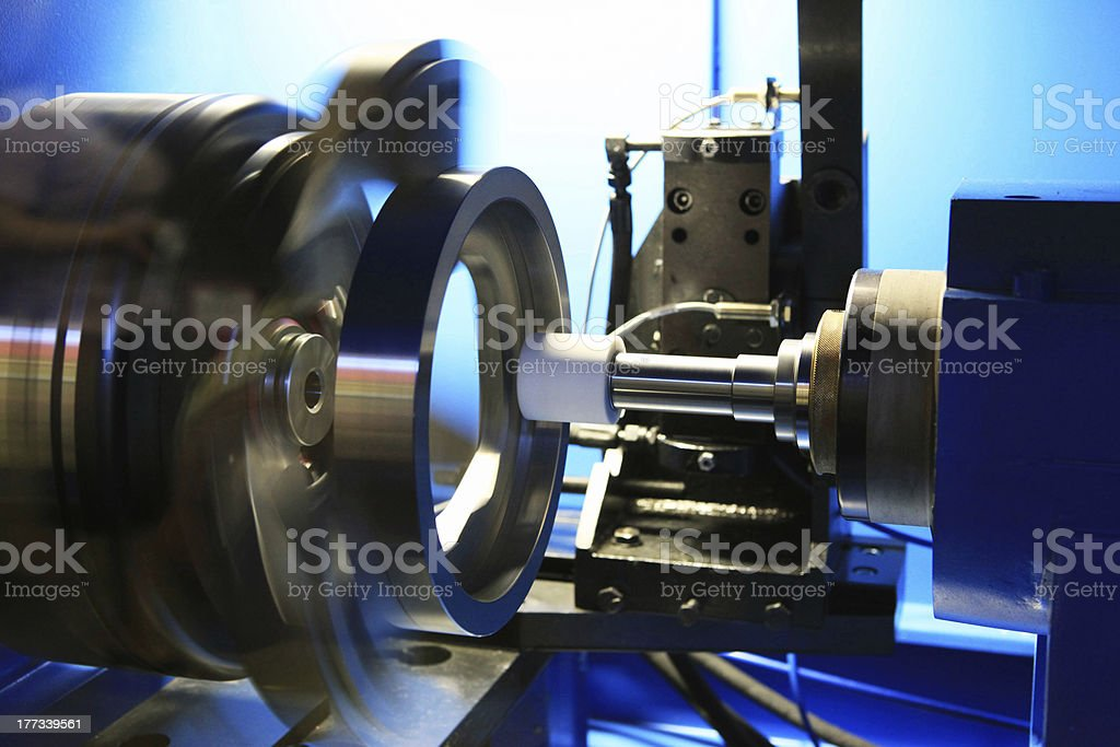 Industrial grinding machine in a factory stock photo