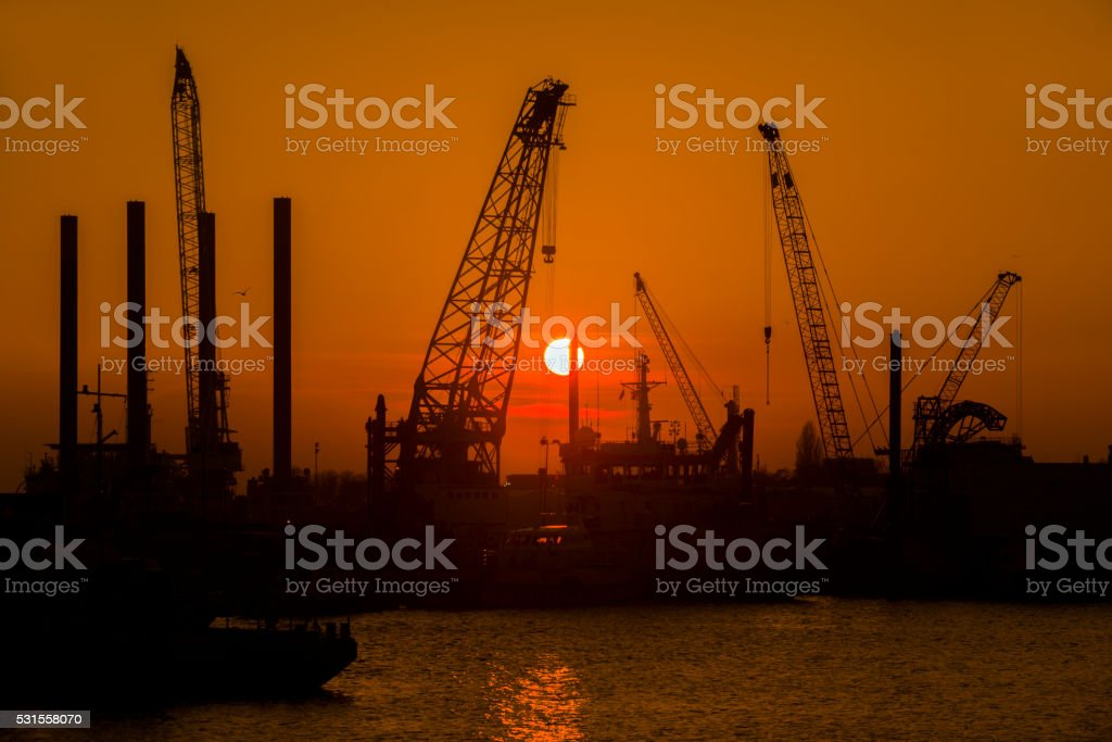 Industrial harbor at sunset stock photo