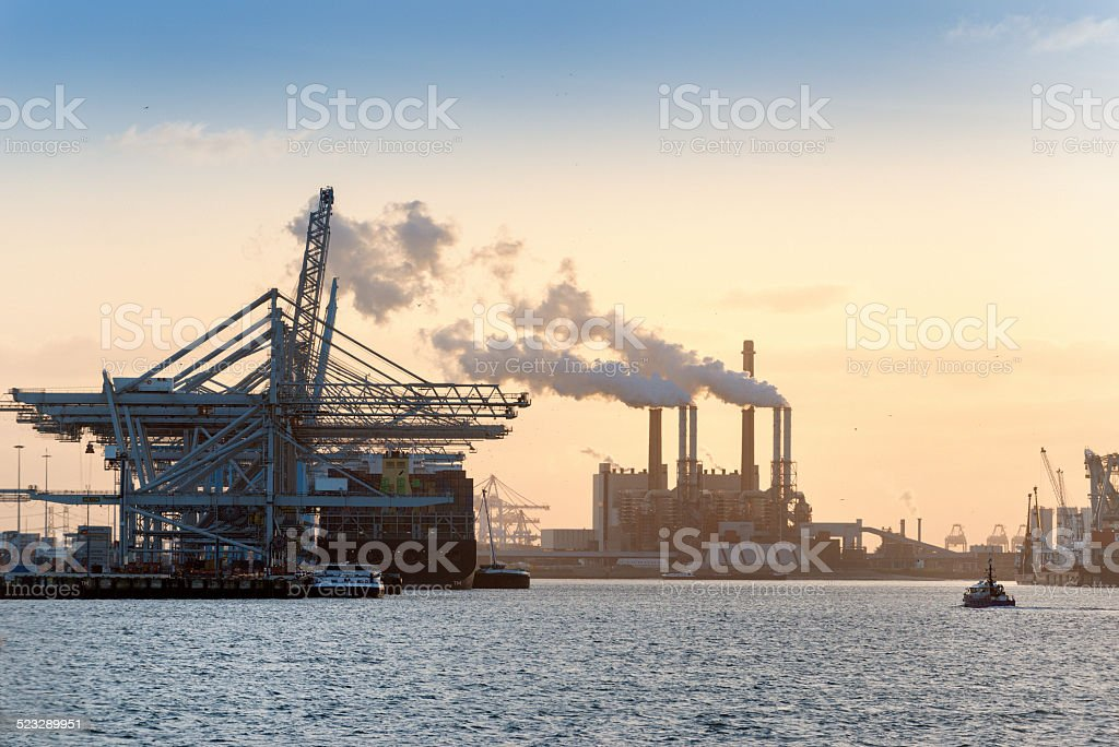 Industrial harbor dock at sunset stock photo
