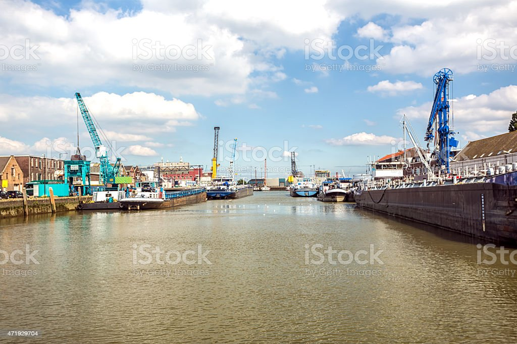 Industrial harbor with ship in Rotterdam stock photo
