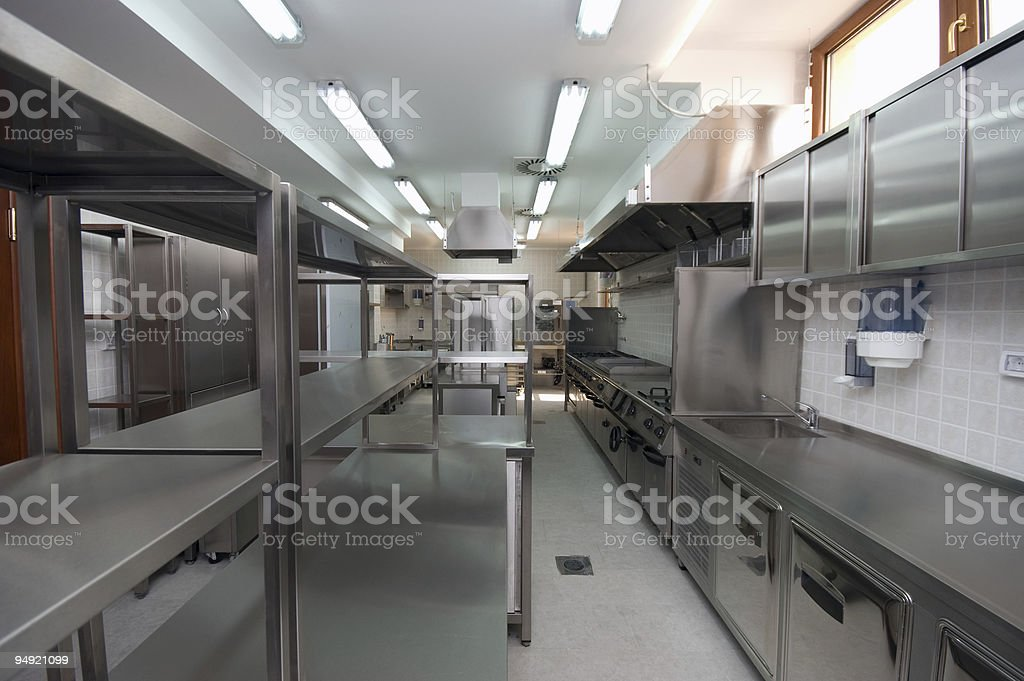 Industrial hotel kitchen with steel shelving royalty-free stock photo