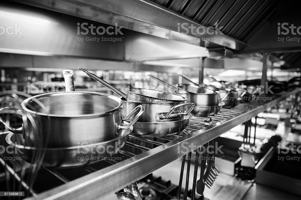 Industrial Kitchen - Pots and tools on shelves stock photo