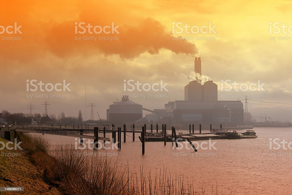 Industrial landscape in evening fog royalty-free stock photo