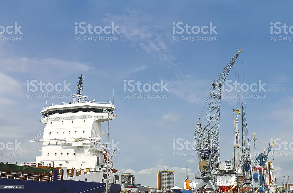 Industrial landscape. Ship and crane in shipyard royalty-free stock photo
