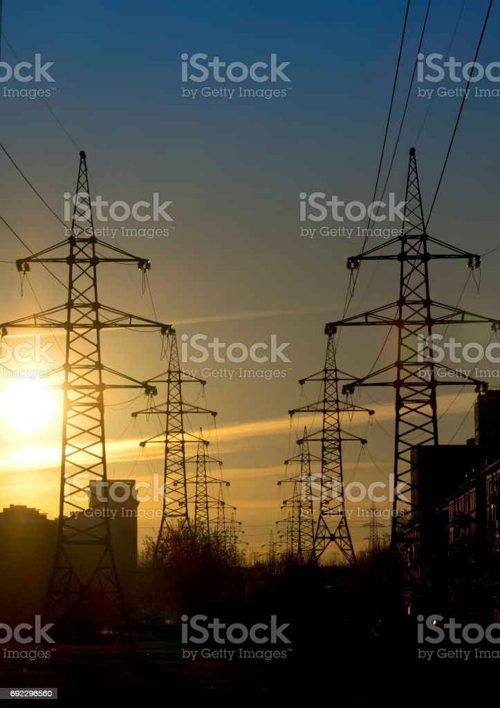 Industrial landscape. Sunset over the power line stock photo