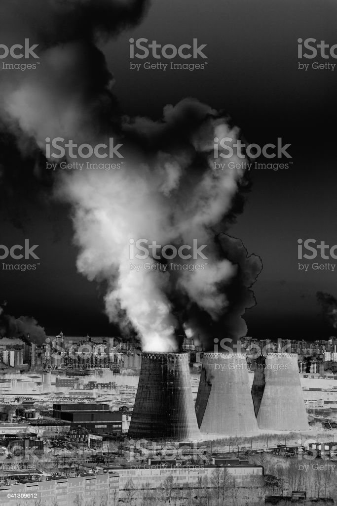 Industrial landscape with factory pipe polluting air, smoke from chimneys stock photo