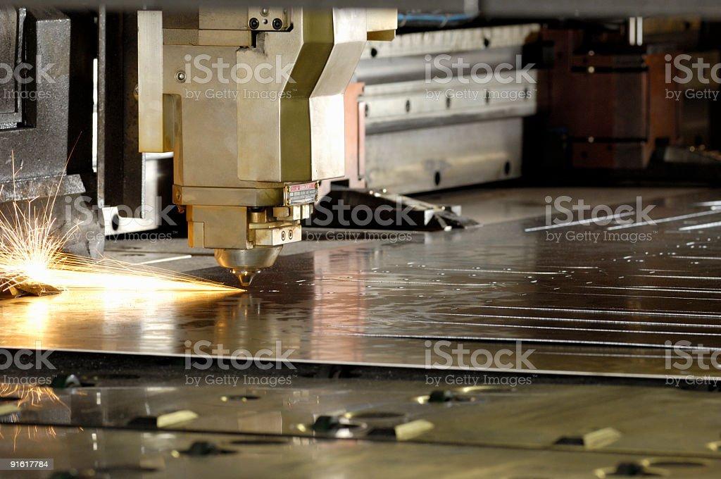 Industrial Laser metal cutting tool stock photo