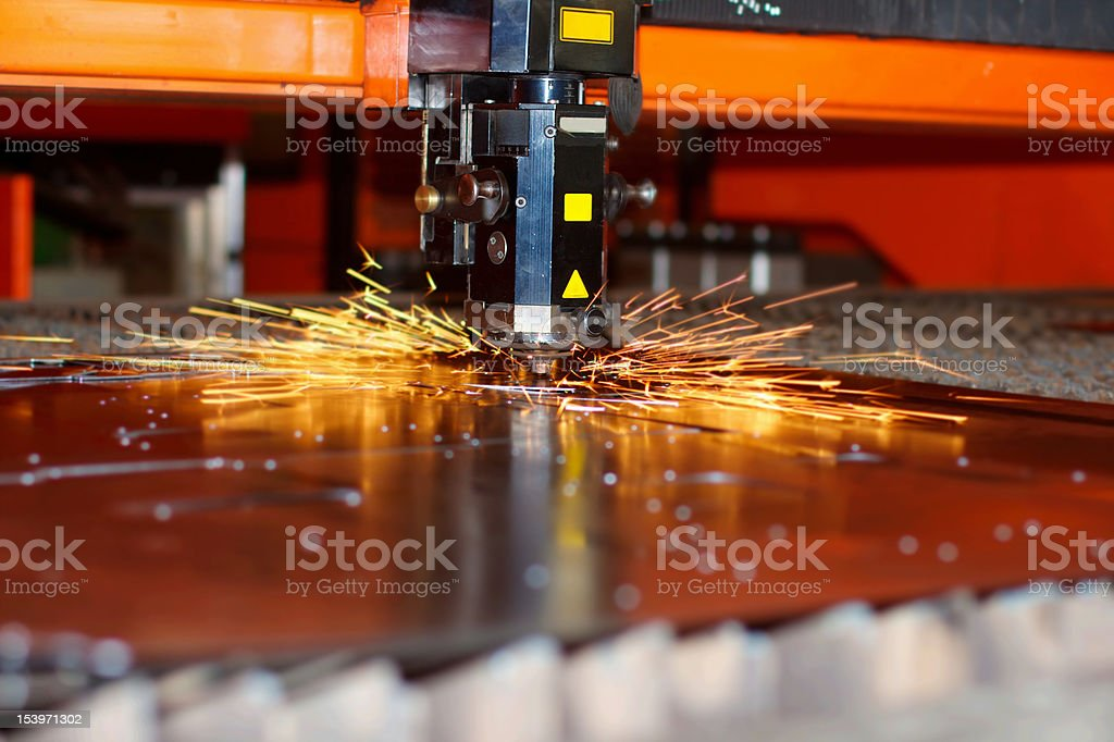 Industrial laser with sparks stock photo