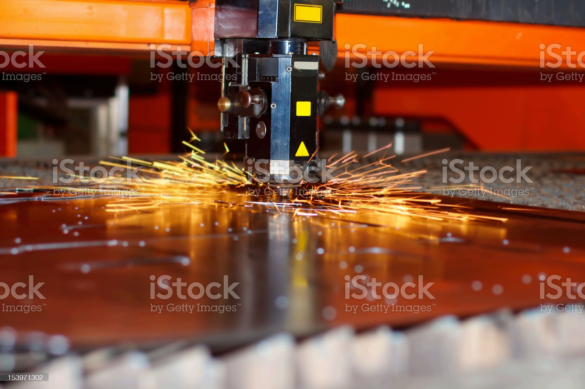 Industrial laser with sparks royalty-free stock photo