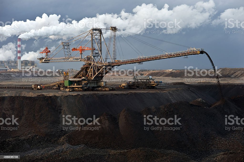 Industrial machinery (spreader) at work in coal mine. stock photo