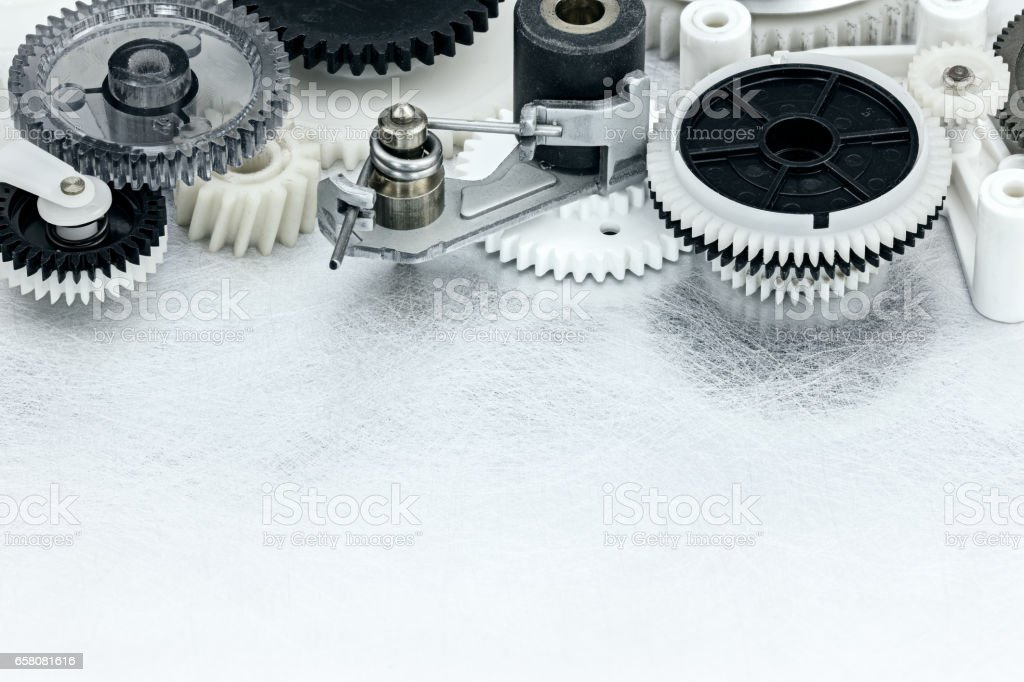 industrial metal background with plastic black and white cogwheels stock photo